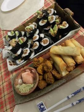 Vegan sushi with spring rolls and vegetable pakora