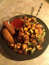 Scratch made tofu teriyaki with egg rolls