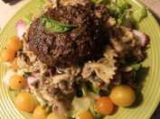 "Vegan ""Scotch Egg"" on mushroom bow-tie pasta"