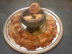 Vegan meatball roll-up ring with basil marinara